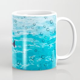Orca Whale gliding through the water on a rainy day Coffee Mug