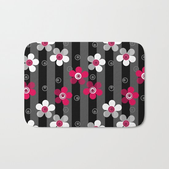 Crimson and white flowers on a black striped background Bath Mat