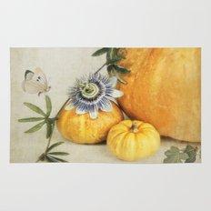 pumpkin & passiflora Rug