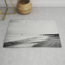 black and white Southwold beach photograph Rug