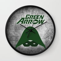 green arrow Wall Clocks featuring The Green Arrow by bivisual
