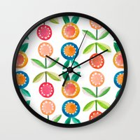 water colour Wall Clocks featuring Water colour flowers by catherineinsch