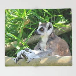 Cute and relaxed Ring-tailed lemur (lemur catta) Throw Blanket