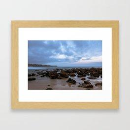 Rocks at the beach Framed Art Print