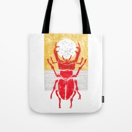 Red stag facing a golden sky Tote Bag