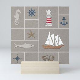 Nautical symbols on sandy background Mini Art Print