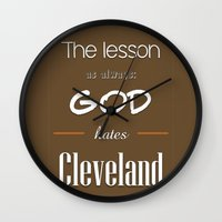 lebron Wall Clocks featuring God Hates Cleveland by thebuccanear
