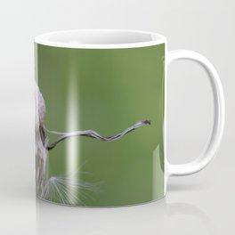 Resistance - Dandelion on green blurry background Coffee Mug