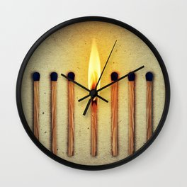 match burning alone Wall Clock