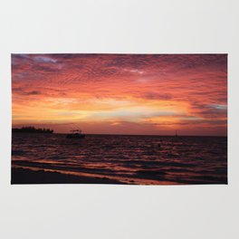 sunset by the sea Rug