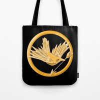 mockingjay Tote Bags featuring Mockingjay by AriesNamarie