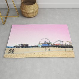 Santa Monica Pier with Ferries Wheel and Roller Coaster Against a Pink Sky Rug