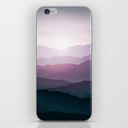 dark blue mountain landscape with fog and a sunrise and sunset iPhone Skin