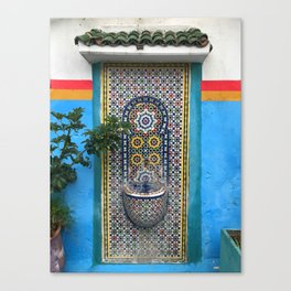Turquoise wall and water fountain in Morocco Canvas Print