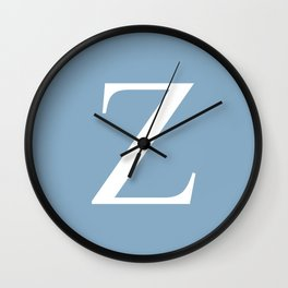 Letter Z sign on placid blue background Wall Clock