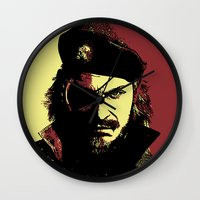 metal gear solid Wall Clocks featuring Big Boss (naked snake from metal gear solid) by TxzDesign