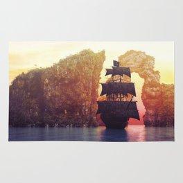 A pirate ship off an island at a sunset Rug