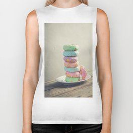 A stack of donuts on wooden table against the wall Biker Tank