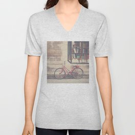 A vintage red bicycle and the bookstore photograph Unisex V-Neck