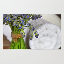 Fresh  lavender flowers, zen stones,Herbal massage balls , candle and towel over wooden surface Rug