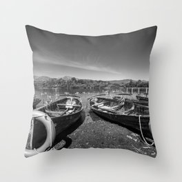 Rowing boats on shore of Lake Derewentwater in English Lake District Throw Pillow