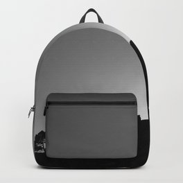 Sun through the mountains and trees. Al sunset Backpack