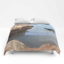 Dog on the beach Comforters