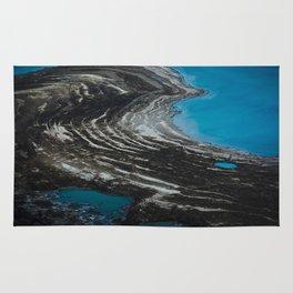 Shrinking of the Dead Sea Rug