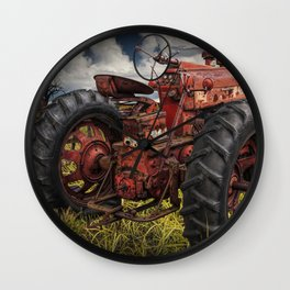 Abandoned Old Farmall Tractor in a Grassy Field on a Farm Wall Clock