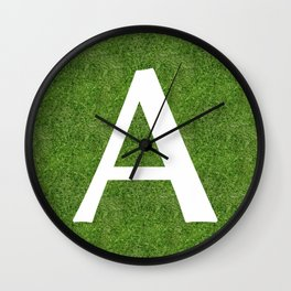 A initial letter alphabet on the grass Wall Clock
