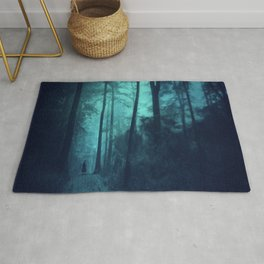 Light in a cyan forest Rug