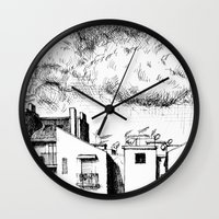 buildings Wall Clocks featuring Buildings by Giuseppe Vassallo