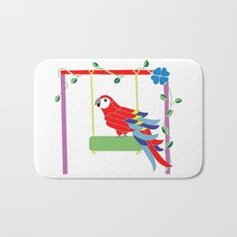 Scarlet macaw in the playground Bath Mat
