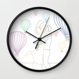 Couple sharing a moment by hot air balloons in Cappadocia, Turkey. Wall Clock