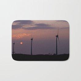 Wind farm at sunset Bath Mat
