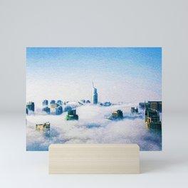 Dubai skyline topped in morning clouds landscape Mini Art Print