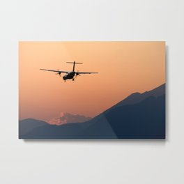 Airplane landing at sunset on the summer solstice Metal Print