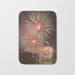Rose, Yellow and Purple Fireworks over a Pond with Lilypads Bath Mat
