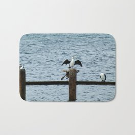 Resting cormorants Bath Mat