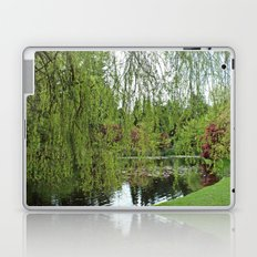 Lovely, soft green spring willow tree by the pond Laptop & iPad Skin