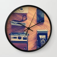 cameras Wall Clocks featuring Cameras by tycejones