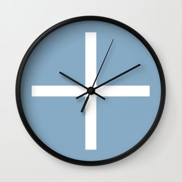 white cross on placid blue background Wall Clock