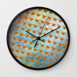 Orange butterflies flying in formation Wall Clock