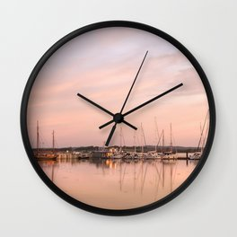 Pink sundown at the sea Wall Clock