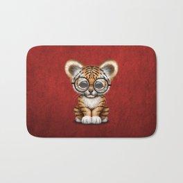 Cute Baby Tiger Cub Wearing Eye Glasses on Deep Red Bath Mat