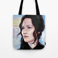 katniss Tote Bags featuring Katniss Everdeen by Alina Rubanenko