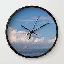 Romantic View on the Waddenzee in Holland with a Sailboat, blue Sky and white Clouds Wall Clock