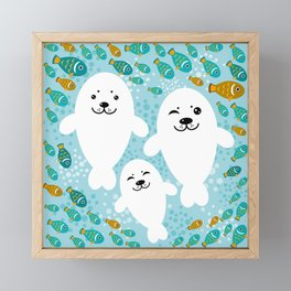 happy family of white seals and fish on a blue background. Framed Mini Art Print
