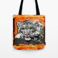 snow leopard Tote Bags featuring Snow Leopard by SwanniePhotoArt