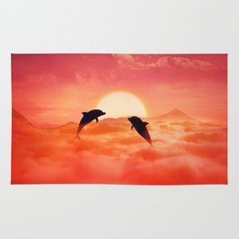 flying dolphins sunset Rug